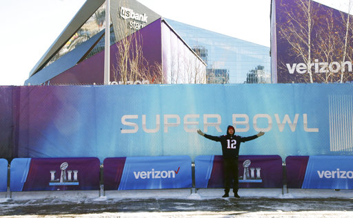 <div class='meta'><div class='origin-logo' data-origin='none'></div><span class='caption-text' data-credit='AP'>A New England Patriots fan poses with U.S. Bank Stadium in the background before the Super Bowl, Sunday, Feb. 4, 2018, in Minneapolis. AP Photo/Jim Mone)</span></div>