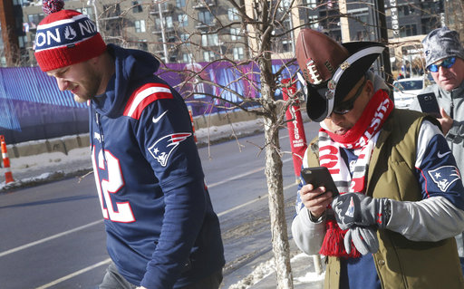<div class='meta'><div class='origin-logo' data-origin='none'></div><span class='caption-text' data-credit='AP'>Two New England Patriots fans head to U.S. Bank Stadium for the Super Bowl against the Philadelphia Eagles, Sunday, Feb. 4, 2018, in Minneapolis. AP Photo/Jim Mone)</span></div>