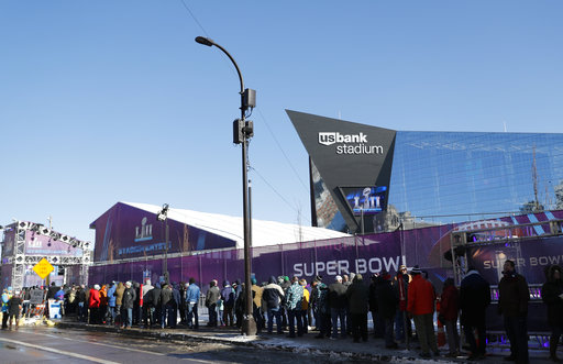 <div class='meta'><div class='origin-logo' data-origin='none'></div><span class='caption-text' data-credit='AP'>Fans wait to get into U.S. Bank Stadium before Super Bowl LII Sunday, Feb. 4, 2018, in Minneapolis. (AP Photo/Jeff Roberson)</span></div>