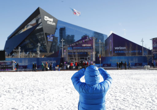 <div class='meta'><div class='origin-logo' data-origin='none'></div><span class='caption-text' data-credit='AP'>A fan takes a picture outside U.S. Bank Stadium before Super Bowl LII Sunday, Feb. 4, 2018, in Minneapolis. (AP Photo/Jeff Roberson)</span></div>