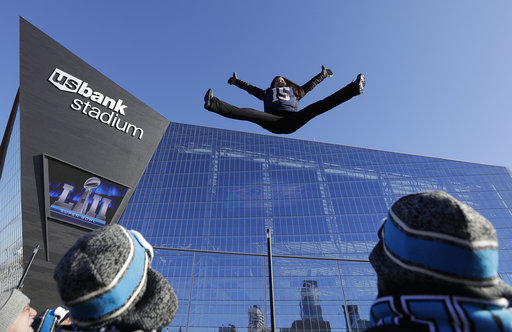 <div class='meta'><div class='origin-logo' data-origin='none'></div><span class='caption-text' data-credit='AP'>A fan jumps on a trampoline outside U.S. Bank Stadium before Super Bowl LII Sunday, Feb. 4, 2018, in Minneapolis. (AP Photo/Eric Gay)</span></div>