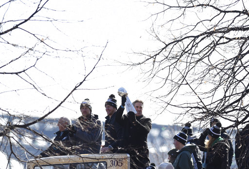 <div class='meta'><div class='origin-logo' data-origin='AP'></div><span class='caption-text' data-credit='AP'>Philadelphia Eagles head coach holds up the Vince Lombardi Trophy with quarterbacks Carson Wentz and Nick Foles during the Super Bowl LII victory parade. (AP Photo/Michael Perez)</span></div>