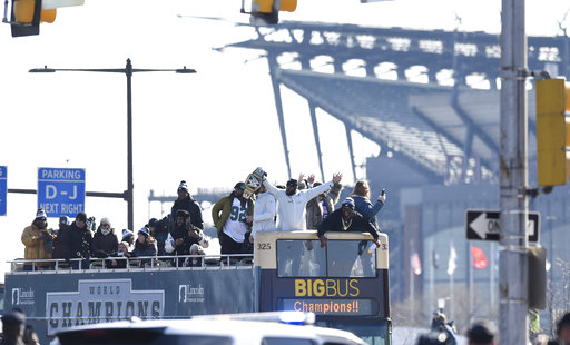 <div class='meta'><div class='origin-logo' data-origin='AP'></div><span class='caption-text' data-credit='AP'>Philadelphia Eagles NFL football team players gesture to fansduring the Super Bowl LII victory parade, Thursday, Feb 8, 2018, in Philadelphia. (AP Photo/Michael Perez)</span></div>
