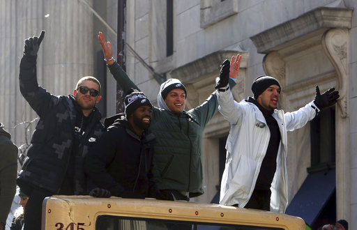 <div class='meta'><div class='origin-logo' data-origin='AP'></div><span class='caption-text' data-credit='AP'>Philadelphia Eagles wide receivers Zach Ertz, and Mack Hollins ride with teammates in the Eagles team parade Thursday Feb. 8, 2018, in Philadelphia. (AP Photo/Jacqueline Larma)</span></div>