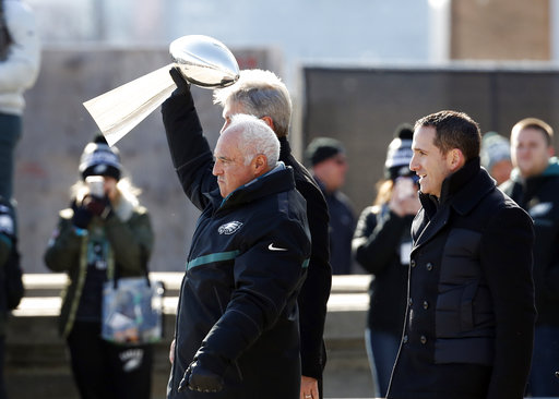 <div class='meta'><div class='origin-logo' data-origin='AP'></div><span class='caption-text' data-credit='AP'>Philadelphia Eagles owner Jeffrey Lurie holds the Vince Lombardi trophy up with head coach Doug Pederson, and general manager Howie Roseman. (AP Photo/Alex Brandon)</span></div>