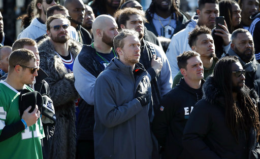 <div class='meta'><div class='origin-logo' data-origin='AP'></div><span class='caption-text' data-credit='AP'>Philadelphia Eagles quarterback Nick Foles stands during the national anthem in front of the Philadelphia Museum of Art after a Super Bowl victory parade. (AP Photo/Alex Brandon)</span></div>