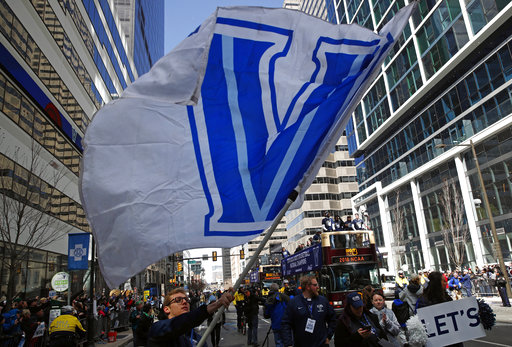 <div class='meta'><div class='origin-logo' data-origin='AP'></div><span class='caption-text' data-credit='(AP Photo/Patrick Semansky)'>A student waves a Villanova flag in front of buses carrying members of the Villanova basketball team, Thursday, April 5, 2018, in Philadelphia.(AP</span></div>