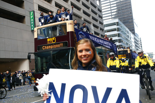 <div class='meta'><div class='origin-logo' data-origin='AP'></div><span class='caption-text' data-credit='(AP Photo/Patrick Semansky)'>Members of the Villanova basketball team wave to fans from atop a bus during a parade celebrating their NCAA college basketball championship, Thursday, April 5, 2018.</span></div>