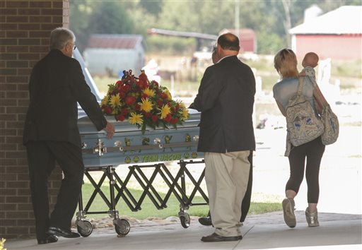 <div class='meta'><div class='origin-logo' data-origin='none'></div><span class='caption-text' data-credit='Ken Ruinard/The Independent-Mail via AP, Pool'>The casket of Jacob Hall arrives for a wake service at Oakdale Baptist Church in Townville, S.C.</span></div>