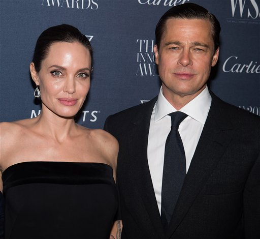 <div class='meta'><div class='origin-logo' data-origin='none'></div><span class='caption-text' data-credit='Charles Sykes/Invision/AP'>Angelina Jolie Pitt and Brad Pitt attend the WSJ Magazine Innovator Awards 2015 at The Museum of Modern Art on Nov. 4, 2015, in New York. (Photo by Charles Sykes/Invision/AP)</span></div>