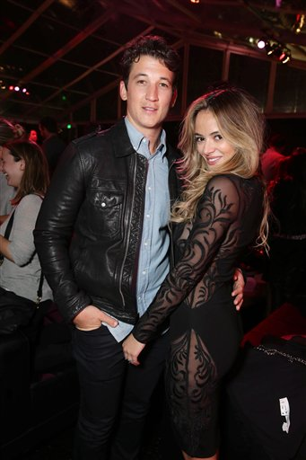 <div class='meta'><div class='origin-logo' data-origin='none'></div><span class='caption-text' data-credit='Eric Charbonneau/Invision/AP'>Exclusive - Miles Teller and Keleigh Sperry seen at Los Angeles World Premiere of New Line Cinema?s and Metro-Goldwyn-Mayer Pictures' 'Creed'</span></div>