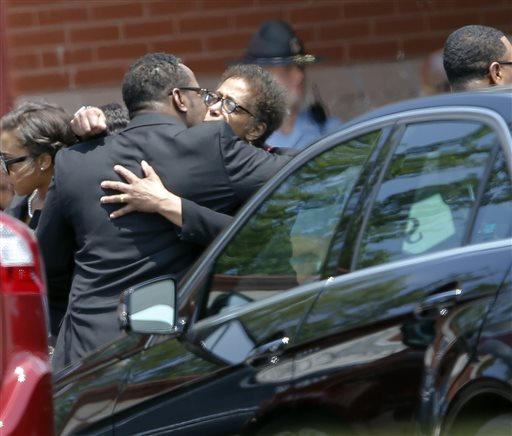 <div class='meta'><div class='origin-logo' data-origin='none'></div><span class='caption-text' data-credit='AP'>R&B singer Bobby Brown hugs an unidentified woman after a funeral service for his daughter, Bobbi Kristina Brown, Saturday, Aug. 1, 2015, in Alpharetta, Ga.</span></div>