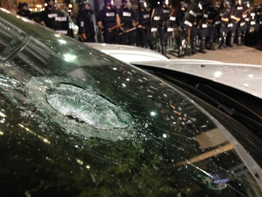 "<div class=""meta image-caption""><div class=""origin-logo origin-image none""><span>none</span></div><span class=""caption-text"">A police vehicle is damaged as police fire teargas as protestors converge on downtown following Tuesday's police shooting of Keith Lamont Scott in Charlotte, N.C. (AP)</span></div>"