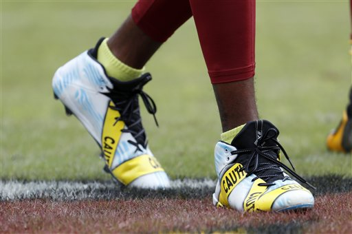 "<div class=""meta image-caption""><div class=""origin-logo origin-image ap""><span>AP</span></div><span class=""caption-text"">Washington Redskins wide receiver DeSean Jackson (11) wears cleats with a police tape theme during warm ups before an NFL football game Sunday, Oct. 2, 2016, in Landover, Md. (AP Photo/Carolyn Kaster)</span></div>"