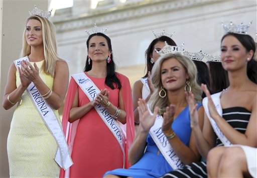 <div class='meta'><div class='origin-logo' data-origin='none'></div><span class='caption-text' data-credit='AP'>Miss Virginia, Michaela Gabriella, Miss Washington, Alicia Cooper and others applaud during Miss America Pageant arrival ceremonies Tuesday, Aug. 30, 2016, in Atlantic City.</span></div>