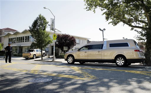 <div class='meta'><div class='origin-logo' data-origin='none'></div><span class='caption-text' data-credit='AP'>A gold colored hearse carrying the coffin bearing the body of Bobby Kristina Brown arrives at Whigham Funeral home in Newark, N.J., early Monday, Aug. 3, 2015.</span></div>