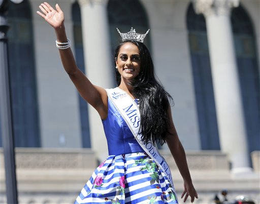 <div class='meta'><div class='origin-logo' data-origin='none'></div><span class='caption-text' data-credit='AP'>Miss Rhode Island, Shruti Nagarajan waves as she is introduced during Miss America Pageant arrival ceremonies Tuesday, Aug. 30, 2016, in Atlantic City</span></div>