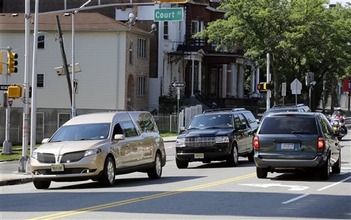 <div class='meta'><div class='origin-logo' data-origin='none'></div><span class='caption-text' data-credit='AP'>A gold colored hearse carrying the coffin bearing the body of Bobbi Kristina Brown drives near Whigham Funeral home in Newark, N.J., early Monday, Aug. 3, 2015.</span></div>