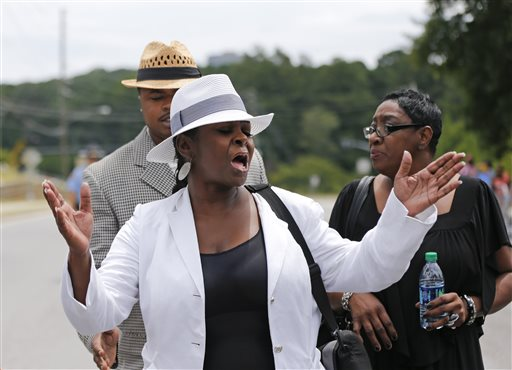 <div class='meta'><div class='origin-logo' data-origin='none'></div><span class='caption-text' data-credit='AP'>Leolah Brown talks with media members outside the church hosting a funeral service for her brother Bobby Brown's daughter, Bobbi Kristina Brown, Saturday, Aug. 1, 2015</span></div>