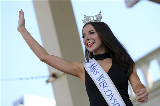 <div class='meta'><div class='origin-logo' data-origin='none'></div><span class='caption-text' data-credit='AP'>Miss Wisconsin, Courtney Pelot waves as she is introduced during Miss America Pageant arrival ceremonies Tuesday, Aug. 30, 2016, in Atlantic City</span></div>