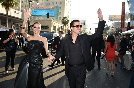 <div class='meta'><div class='origin-logo' data-origin='none'></div><span class='caption-text' data-credit='John Shearer/Invision/AP'>Angelina Jolie and Brad Pitt arrive at the world premiere of &#34;Maleficent&#34; at the El Capitan Theatre on Wednesday, May 28, 2014, in Los Angeles. (Photo by John Shearer/Invision/AP)</span></div>