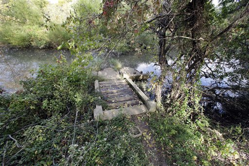 <div class='meta'><div class='origin-logo' data-origin='none'></div><span class='caption-text' data-credit='AP'>An old stairway leads to a branch of the Cooper River, in Cooper River park, in the area where 3-year-old Brendan Creato was found dead.</span></div>