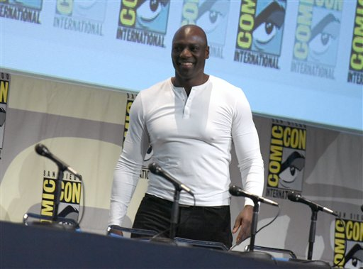 "<div class=""meta image-caption""><div class=""origin-logo origin-image none""><span>none</span></div><span class=""caption-text"">Adewale Akinnuoye-Agbaje walks onstage at the ""Suicide Squad"" panel on day 3 of Comic-Con International on Saturday, July 11, 2015 (Richard Shotwell/Invision/AP)</span></div>"
