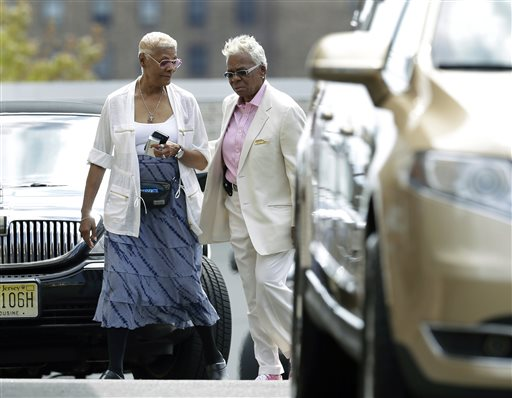 <div class='meta'><div class='origin-logo' data-origin='none'></div><span class='caption-text' data-credit='AP'>Singer Dionne Warwick, left, walks with Carolyn Whigham, right, to a service at Whigham funeral home for Bobbi Kristina Brown in Newark, N.J., early Monday, Aug. 3, 2015.</span></div>