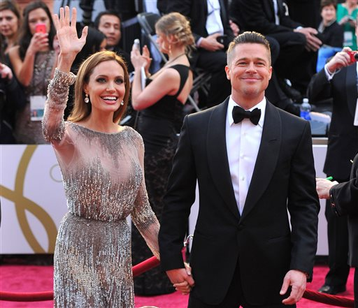 "<div class=""meta image-caption""><div class=""origin-logo origin-image none""><span>none</span></div><span class=""caption-text"">In this Sunday, March 2, 2014, file photo, Angelina Jolie, left, and Brad Pitt arrive at the Oscars (Photo by Vince Bucci/Invision/AP, File) (Vince Bucci/Invision/AP)</span></div>"