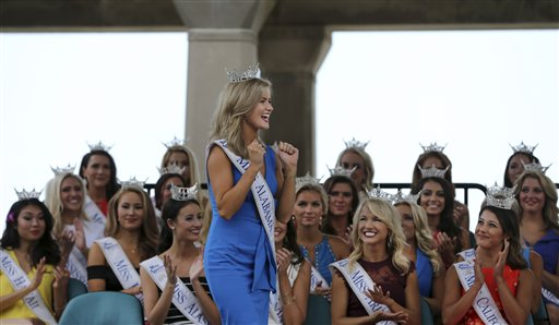 <div class='meta'><div class='origin-logo' data-origin='none'></div><span class='caption-text' data-credit='AP'>Miss Alabama, Hayley Barber reacts during Miss America Pageant arrival ceremonies Tuesday, Aug. 30, 2016, in Atlantic City.</span></div>