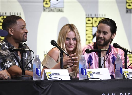 "<div class=""meta image-caption""><div class=""origin-logo origin-image none""><span>none</span></div><span class=""caption-text"">Will Smith, from left, Margot Robbie, and Jared Leto attend the ""Suicide Squad"" panel on day 3 of Comic-Con International on Saturday, July 23, 2016, in San Diego. (Chris Pizzello/Invision/AP)</span></div>"