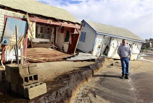 <div class='meta'><div class='origin-logo' data-origin='none'></div><span class='caption-text' data-credit='AP'>A man walks past cottages damaged by superstorm Sandy on Roy Carpenter's Beach in the village of Matunuck, in South Kingstown, R.I. on Oct. 30, 2012. (AP Photo/Steven Senne)</span></div>