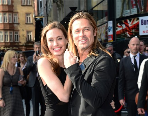 <div class='meta'><div class='origin-logo' data-origin='none'></div><span class='caption-text' data-credit='Jon Furniss/Invision/AP'>Angelina Jolie and Brad Pitt arrive at The World Premiere of 'World War Z' at the Empire Cinema in London on Sunday June 2nd, 2013. (Photo by Jon Furniss/Invision/AP Images)</span></div>