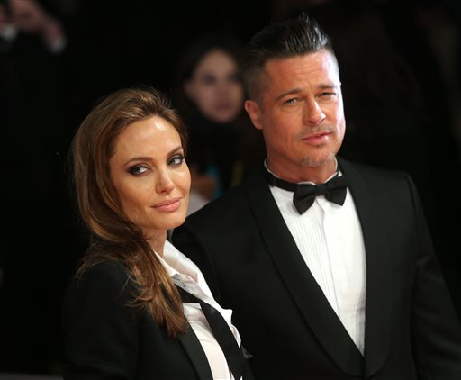 <div class='meta'><div class='origin-logo' data-origin='none'></div><span class='caption-text' data-credit='Joel Ryan/Invision/AP'>Angelina Jolie and Brad Pitt pose for photographers on the red carpet at the EE British Academy Film Awards Feb. 16, 2014, in London. (Photo by Joel Ryan/Invision/AP)</span></div>