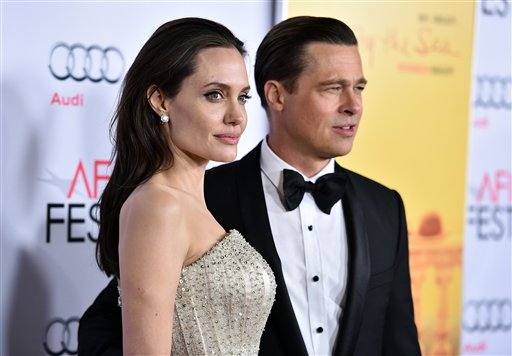 <div class='meta'><div class='origin-logo' data-origin='none'></div><span class='caption-text' data-credit='Jordan Strauss/Invision/AP'>Angelina Jolie and Brad Pitt arrive at the 2015 AFI Fest opening night premiere of &#34;By The Sea&#34; Nov. 5, 2015, in Los Angeles. (Photo by Jordan Strauss/Invision for Audi/AP Images)</span></div>