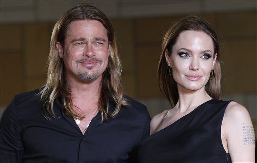 "<div class=""meta image-caption""><div class=""origin-logo origin-image none""><span>none</span></div><span class=""caption-text"">Brad Pitt and Angelina Jolie pose for photographers upon arrival for the Japan premiere of ""World War Z"" in Tokyo, Monday, July 29, 2013. (AP Photo/Shizuo Kambayashi) (AP)</span></div>"