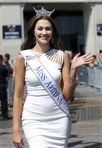 <div class='meta'><div class='origin-logo' data-origin='none'></div><span class='caption-text' data-credit='AP'>Miss Arizona, Katelyn Niemiec waves during Miss America Pageant arrival ceremonies Tuesday, Aug. 30, 2016, in Atlantic City.</span></div>