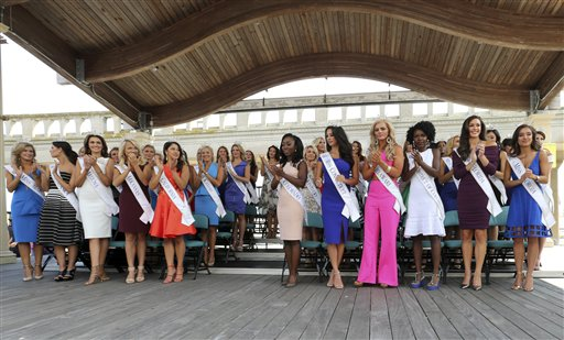 <div class='meta'><div class='origin-logo' data-origin='none'></div><span class='caption-text' data-credit='AP'>The contestants applaud during Miss America Pageant arrival ceremonies Tuesday, Aug. 30, 2016, in Atlantic City.</span></div>