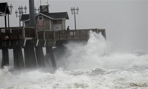 <div class='meta'><div class='origin-logo' data-origin='none'></div><span class='caption-text' data-credit='AP'>Large waves generated by Hurricane Sandy crash into Jeanette's Pier in Nags Head, N.C., Saturday, Oct. 27, 2012</span></div>