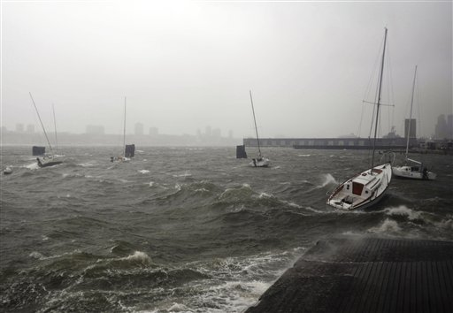 <div class='meta'><div class='origin-logo' data-origin='none'></div><span class='caption-text' data-credit='AP'>Sailboats rock in choppy water at a dock along the Hudson River Greenway during a storm, Monday, Oct. 29, 2012, in New York.</span></div>