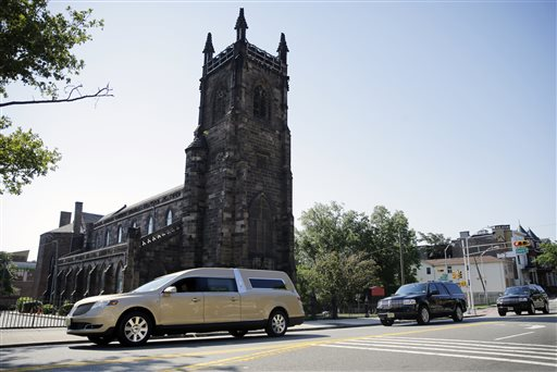 <div class='meta'><div class='origin-logo' data-origin='none'></div><span class='caption-text' data-credit='AP'>A gold colored hearse carrying the coffin bearing the body of Bobby Kristina Brown drives past Saint James Church near Whigham Funeral home in Newark, N.J., Monday, Aug. 3, 2015.</span></div>