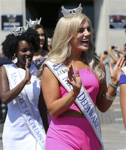 <div class='meta'><div class='origin-logo' data-origin='none'></div><span class='caption-text' data-credit='AP'>Miss Delaware, Amanda Debus waves during Miss America Pageant arrival ceremonies Tuesday, Aug. 30, 2016, in Atlantic City.</span></div>