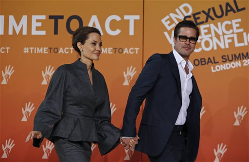 <div class='meta'><div class='origin-logo' data-origin='none'></div><span class='caption-text' data-credit=''>Angelina Jolie, left, special envoy of the United Nations High Commissioner for Refugees, accompanied by her partner Brad Pitt. (AP Photo/Lefteris Pitarakis)</span></div>