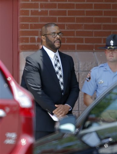 <div class='meta'><div class='origin-logo' data-origin='none'></div><span class='caption-text' data-credit='AP'>Movie and television producer Tyler Perry stands outside St. James United Methodist Church after a memorial for Bobbi Kristina Brown Saturday, Aug. 1, 2015, in Alpharetta, Ga.</span></div>