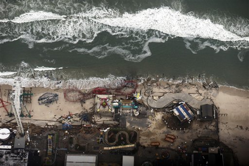 <div class='meta'><div class='origin-logo' data-origin='none'></div><span class='caption-text' data-credit='AP'>In this aerial photo, debris from an amusement park destroyed during Superstorm Sandy lines the beach in Seaside Heights, N.J. Thursday, Nov. 1, 2012.</span></div>