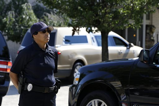 <div class='meta'><div class='origin-logo' data-origin='none'></div><span class='caption-text' data-credit='AP'>An Essex Corrections pollce officer stands guard as a gold colored hearse carrying the coffin bearing the body of Bobby Kristina Brown arrives  at Whigham Funeral home</span></div>