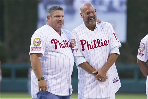 <div class='meta'><div class='origin-logo' data-origin='AP'></div><span class='caption-text' data-credit='AP'>John Kruk, left, looks on with Darren Daulton as they appear for Pat Burrell's induction onto the Phillies' Wall of Fame Friday, July 31, 2015. (AP Photo/Chris Szagola)</span></div>