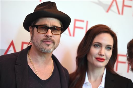 <div class='meta'><div class='origin-logo' data-origin='none'></div><span class='caption-text' data-credit='Jordan Strauss/Invision/AP'>Brad Pitt, left, and Angelina Jolie arrive at the AFI Awards at The Four Seasons Hotel on Friday, Jan. 9, 2015 in Los Angeles. (Photo by Jordan Strauss/Invision/AP)</span></div>