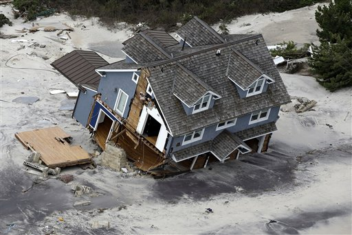<div class='meta'><div class='origin-logo' data-origin='none'></div><span class='caption-text' data-credit='AP'>This aerial photo shows a collapsed house along the central Jersey Shore coast on Wednesday, Oct. 31, 2012.</span></div>