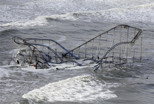<div class='meta'><div class='origin-logo' data-origin='none'></div><span class='caption-text' data-credit='AP'>In this Wednesday, Oct. 31, 2012 file photo, waves wash over a roller coaster from a Seaside Heights, N.J., amusement park that fell in the Atlantic Ocean</span></div>